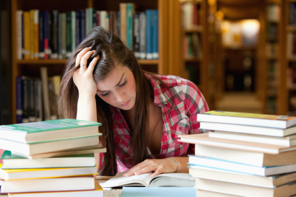Focused student surrounded by books